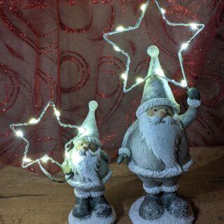 Kerstman met zilveren LED-ster